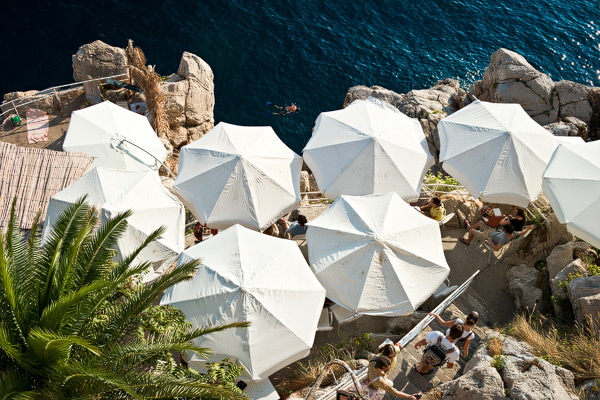 A beach with umbrellas in the old city of Dubrovnik